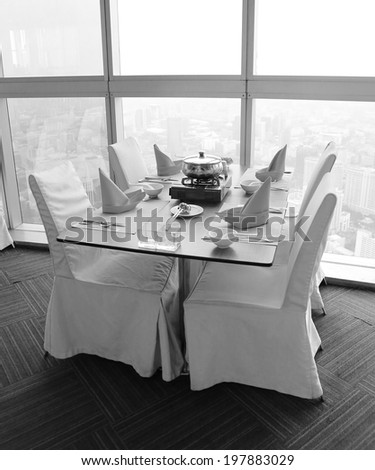 Table set for a elegant dinner , black and white.