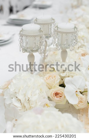 Table set for an event party or wedding reception, orchid  theme - stock photo