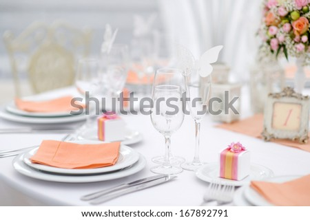 Table set for an event party or wedding reception, spring theme - stock photo