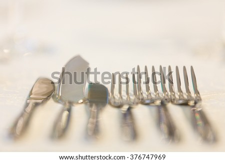 Table set for fine dining with cutlery. Artistic cutlery fork and knife. - stock photo