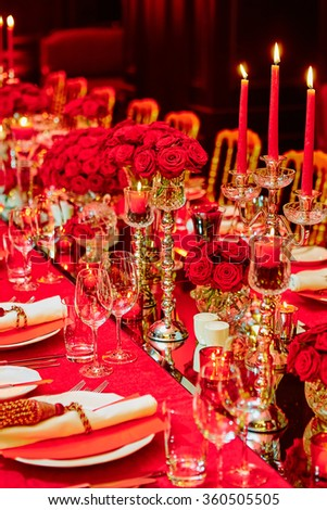 Table set for wedding or another catered event dinner. - stock photo