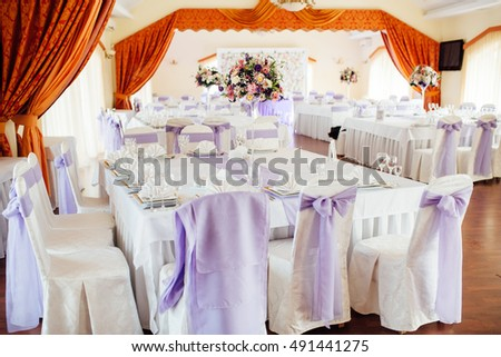 table set for wedding or another catered event dinner ceremony. for newlyweds