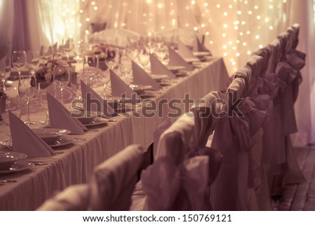 table set for wedding or another catered event dinner - colorized photo - stock photo