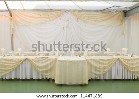 table set for wedding or another catered event dinner - front view - stock photo