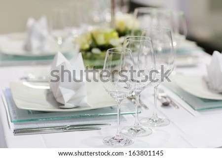Table set in green and white for wedding or event party - stock photo