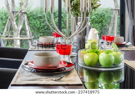 table set in modern dinning room at home - stock photo