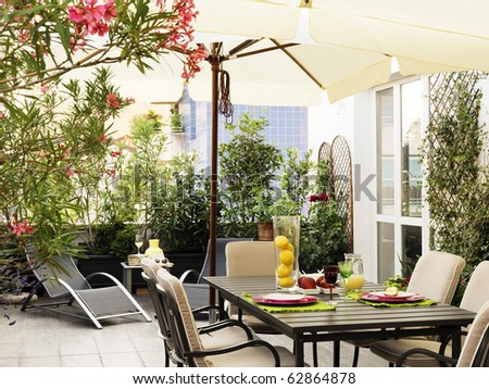 table set in terrace - stock photo