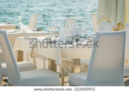 table set on the sea - stock photo