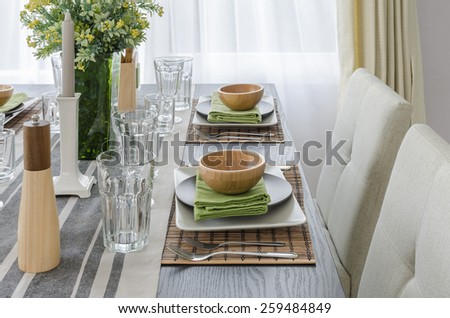 table set on wooden dinning table at home - stock photo