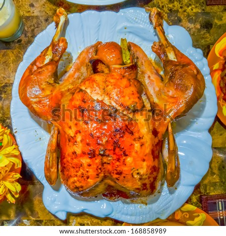table set up before thanksgiving dinner with turkey, gravy, stuffing - stock photo