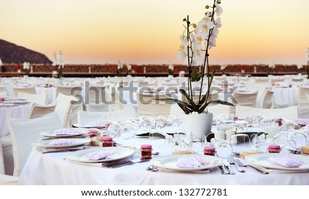 Table set up for a wedding ceremony on beach resort - stock photo