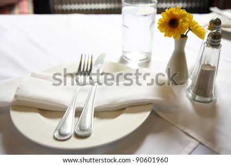 Table set with flower - stock photo