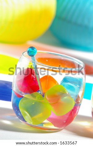 Table setting at a fun, summery party. - stock photo