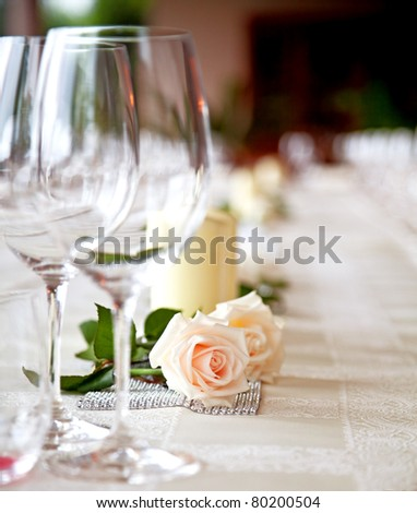Table setting at a restaurant ( two roses on a table)