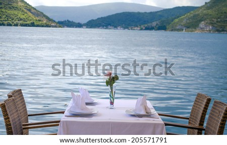 Table setting at beach restaurant. - stock photo