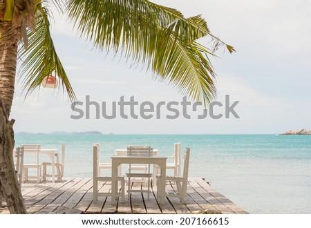 Table setting at beach restaurant - stock photo