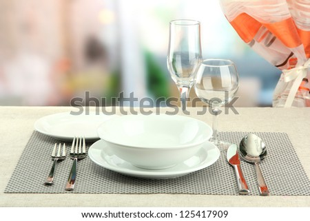 Table setting at restaurant - stock photo
