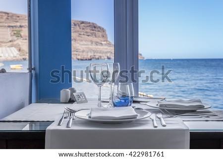Table setting at sea restaurant - Luxurious beach restaurant - A romantic place - stock photo
