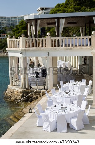 Table setting by the water - stock photo