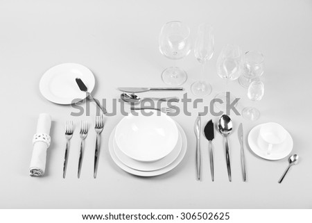 Table setting, close up, on grey background - stock photo