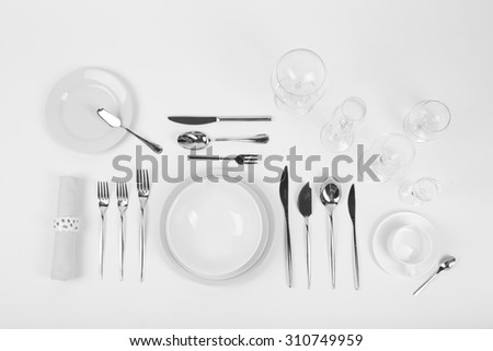 Table setting, close up, on white background - stock photo
