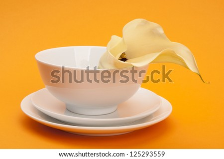 Table setting decorated with calla lily - stock photo