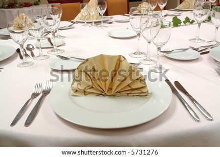 table setting Dinner table for a large party - stock photo