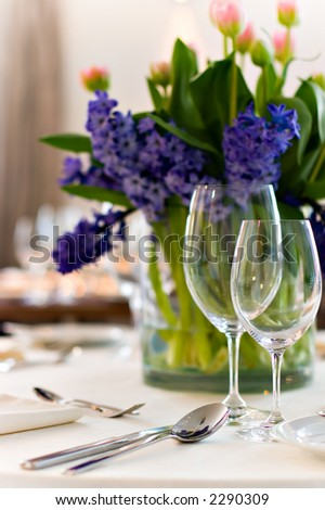 Table setting for a wedding or dinner event, with flowers - stock photo
