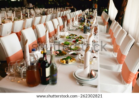 Table setting for an wedding reception in orange color - stock photo