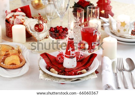 Table setting for Christmas with apple pie and cranberry punch - stock photo
