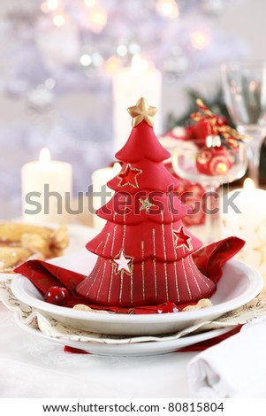 Table setting for Christmas with candle tree - stock photo