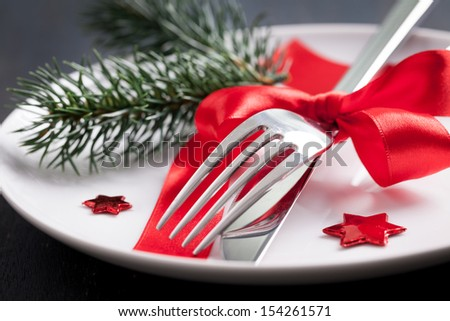 table setting for christmas with red ribbon   - stock photo