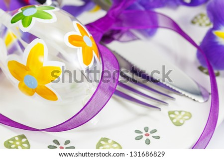 table  setting for Easter with egg and irises - stock photo