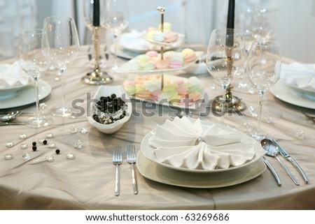 Table setting for elegant wedding dinner - stock photo