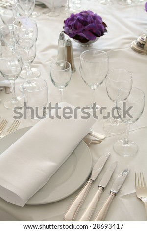 table setting for fine dining or party. cutlery and plate in restaurant set up for wedding celebration - stock photo