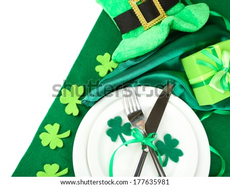 Table setting for St Patricks Day with white background - stock photo