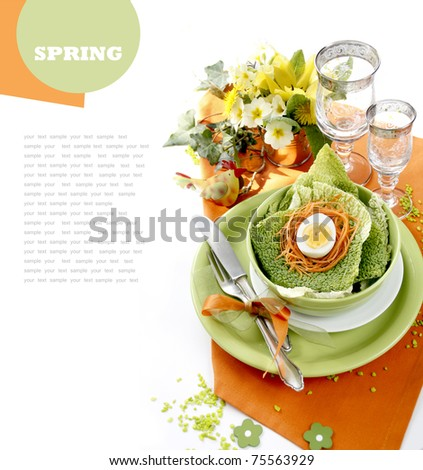 Table setting in green and orange tones - stock photo