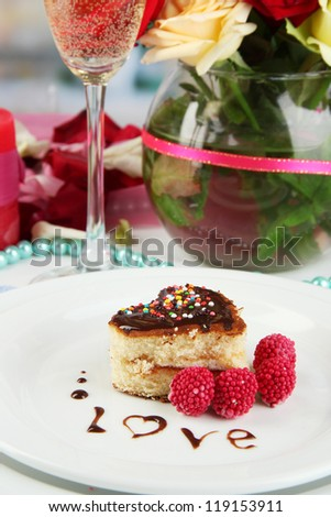 Table setting in honor of Valentine's Day close-up on room background - stock photo