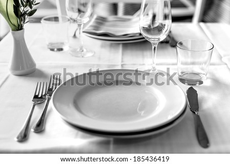 table setting in restaurant interior, desaturated - stock photo