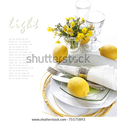 Table setting in white and yellow tones - stock photo