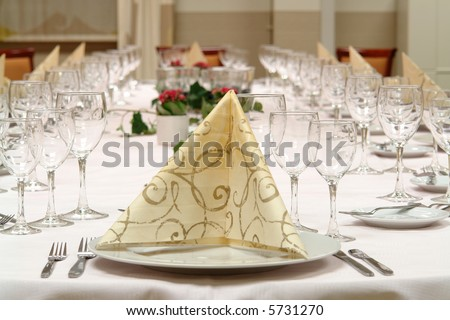 table setting large dinner table set up for a lot of people - stock photo