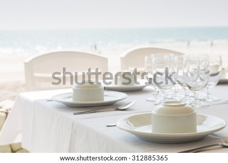 Table setting near beach restaurant