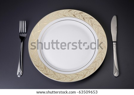 Table setting of plates and cutlery - stock photo