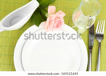 Table setting on a bamboo mat close-up