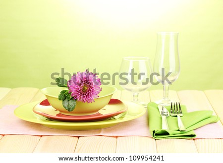 Table setting on bright background close-up - stock photo