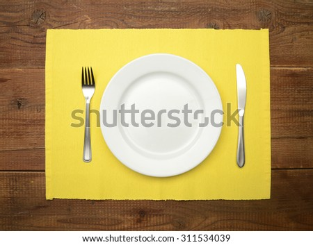 Table setting on wooden rustic dinning table for one person - stock photo