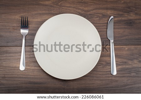 table setting. plate fork knife white empty