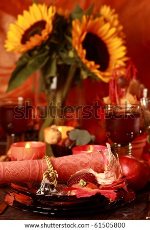 Table setting with autumn decoration for Thanksgiving - stock photo