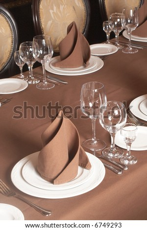 Table setting with brown table-cloth - stock photo