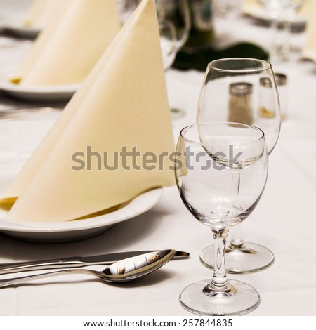 Table setting with empty wine glass at restaurant. - stock photo